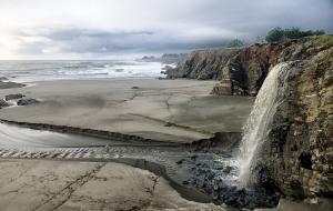 Beautiful waterfall at Stengel Beach by Allen Vinson