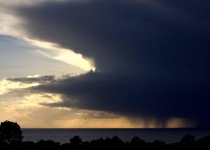 Hail Storm Coming by Robert Scarola