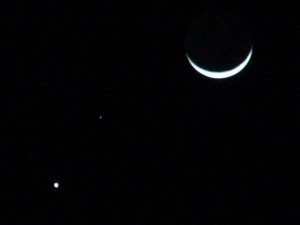 Astronomical Trio - Venus, Mars, and the crescent moon by Larry Riddle