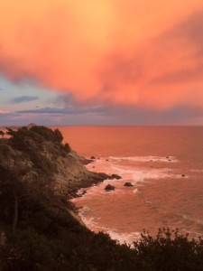 Thundercloud reflected in the Pacific Ocean by Colleen Cross