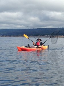 Hal Ferguson fishing from a kayak by Catherine Miller