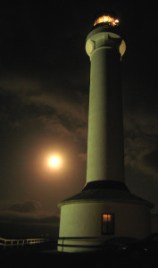 Sturgeon Moon tries to outshine the Point Arena Lighthouse by Glenn Funk