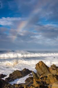 Big waves and rainbows by Craig Tooley