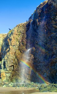 Rainbow in a seasonal waterfall at Black Point Beach by Allen Vinson