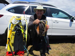 Roger Rude finds a trophy Abalone by Jack Likins