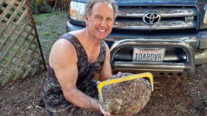 Roger Rude with a huge Abalone by Jack Likins