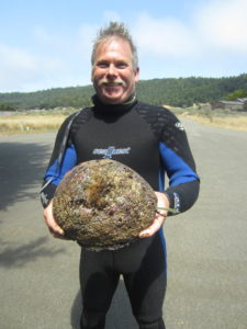 Mel Huse with a trophy Abalone by Jack Likins